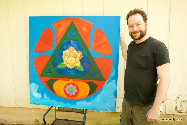 Eric Beverly with new painting (piece for meditation with lotus, triangle, and circle)