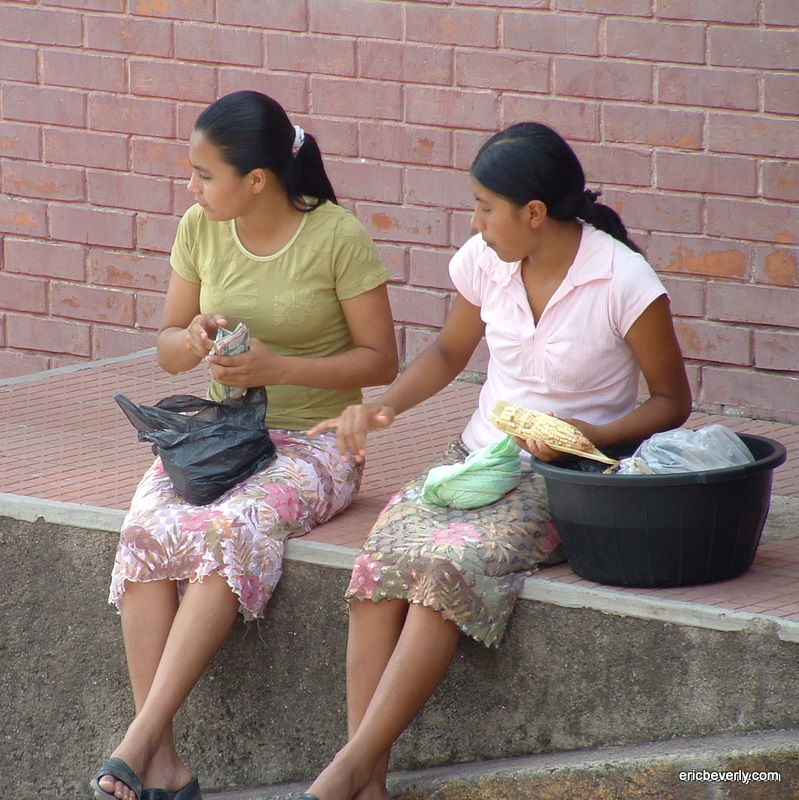 young people eating corn in Copán Ruinas, Honduras
