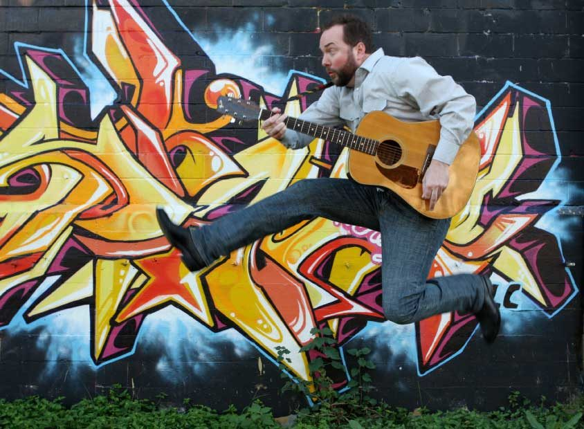 Eric Beverly advances through time and space with his trusty acoustic guitar.